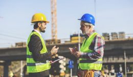 Two Construction Workers Discussing